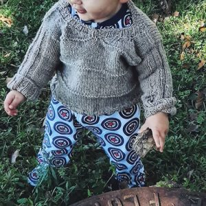 child wearing a sweater made from Romeldale CVM wool