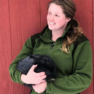 Ashley Pierce holds a Silver Fox rabbit