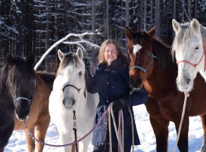 Stephanie Hayes holds Baca Chica horses