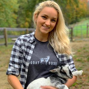 Michelle Nardozzi holding an Arapawa goat kid